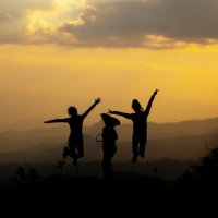 group-happy-people-jumping-mountain-sunset_1150-73532757370147423869580.jpg
